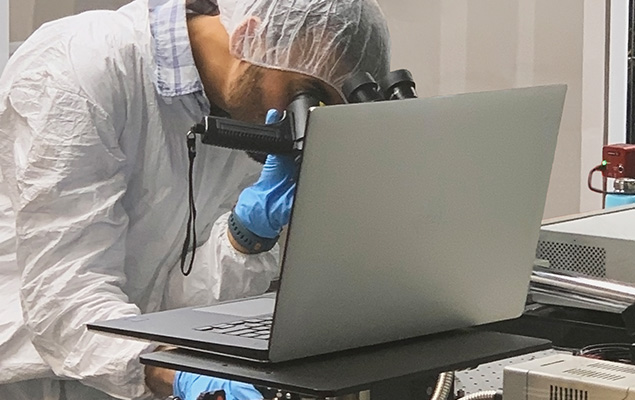 photonic chip tests being performed on laptop in lab