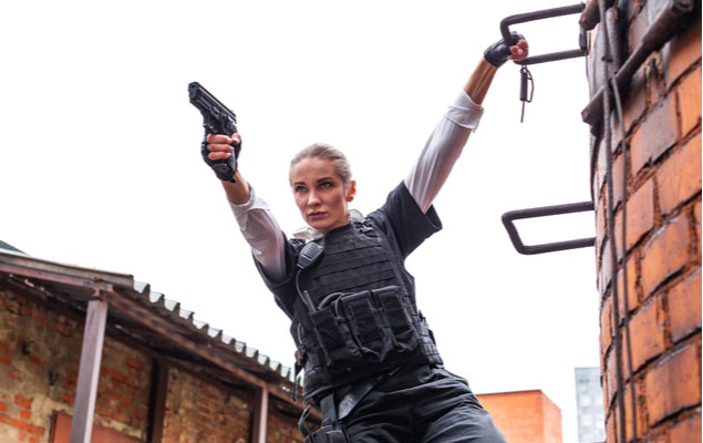 action shot of woman holding a pistol