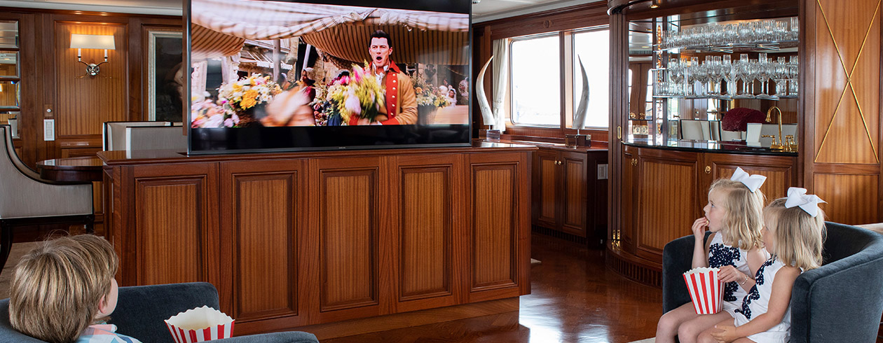 kids watching TV on a superyacht