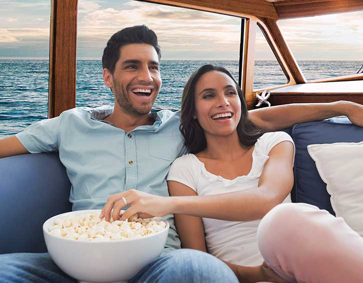 couple watching TV on yacht